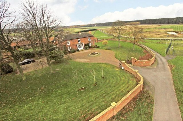 The complex includes a six-bedroom house, detached staff cottage and equestrian facilities including extensive stabling standing in excess of 35 acres in all.