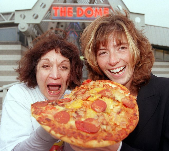 Staff at the the area's two sports Domes - The Doncaster Dome, and Barnsley's Metrodome - delivered a pizza to each other to raise money for Children in Need in 1998. Our picture shows Dome duty manager Shelley Armitgae (right) and the Metrodome's admin/finance officer tucking into one of the pizzas.