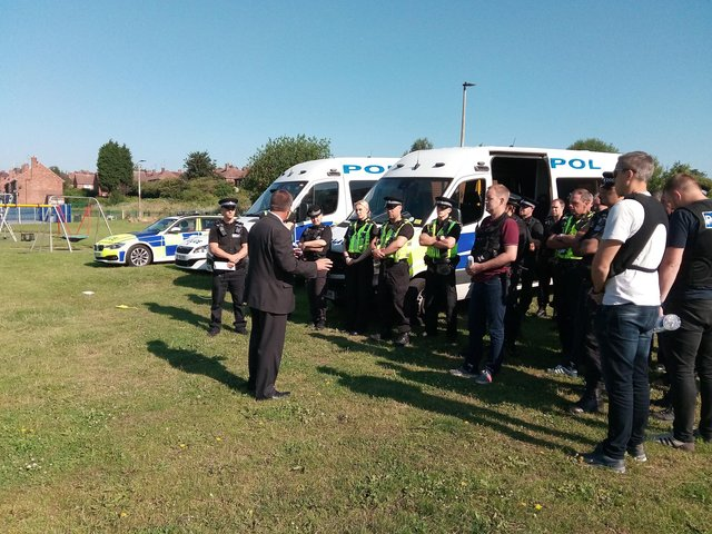 Det Insp Steve Smith briefs police officers at the park on Schofield Street, Mexborough, ahead of a police operation against violent crime across three police districts in 2017
