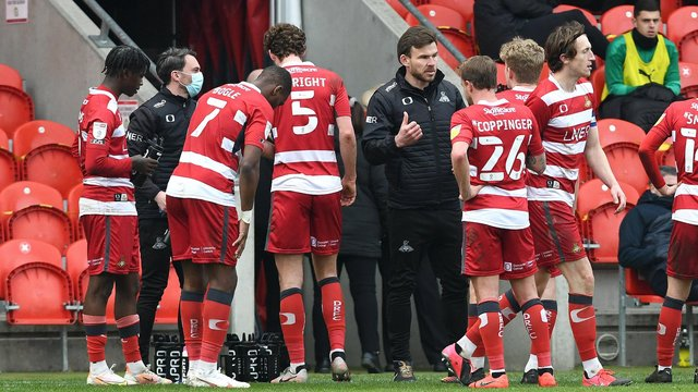 Andy Butler talks to his players during the win over Plymouth Argyle. Picture: Andrew Roe/AHPIX