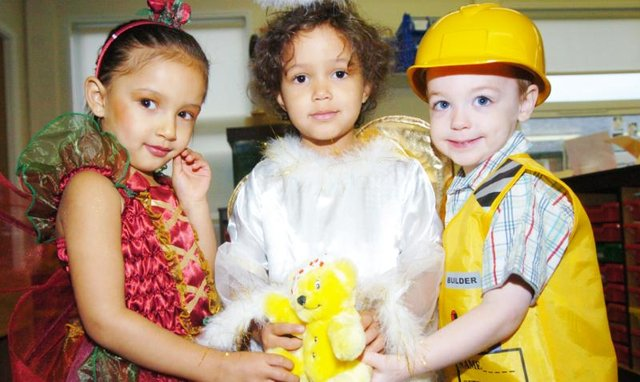 Children at Warren Day Nursery in 2007. They are all dressed up to raise money for charity.
