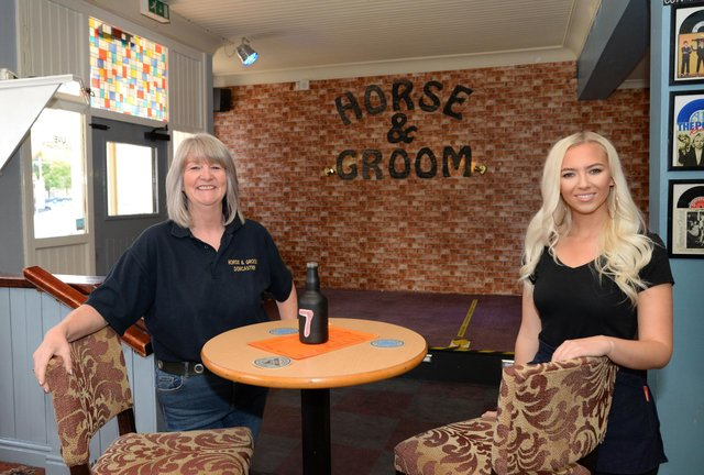 Landlady Ailene Horrocks and Amelia Davey, Bar staff member, pictured by the stage. Picture: NDFP-22-09-20-Horse&Groom 2-NMSY