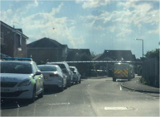 Police sealed off Thorpehall Road after shots were fired at a house.
