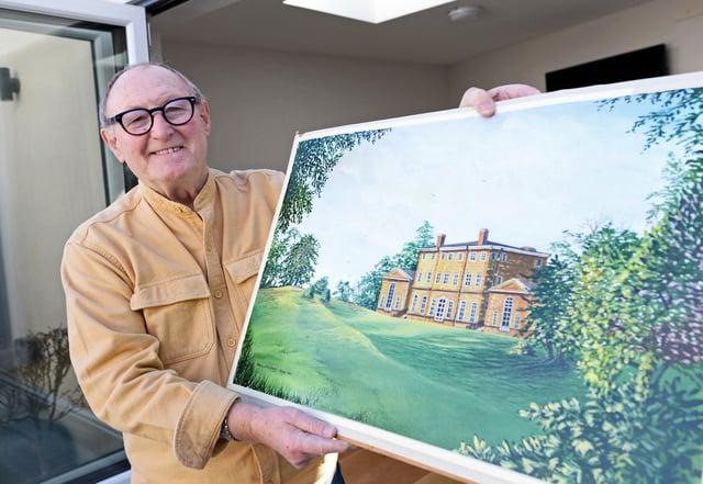 John, holds a painting of Cusworth Hall.
