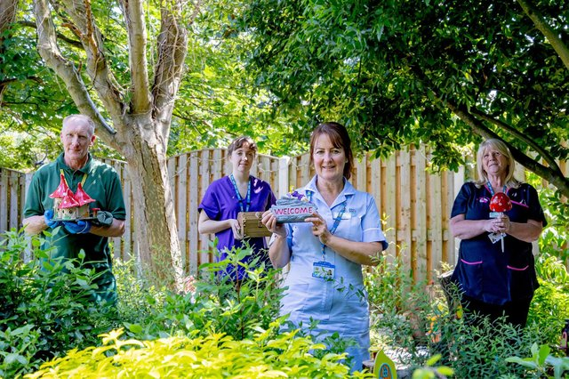In the Fairy Garden at St John's Hospice: Hospice Nursing Assistant Michelle Hannan, is pictured with some of the garden's attractions and L-R Grounds and Gardens Supervisor Alan Pakeman, Rachel Horne and Linda Rowe.