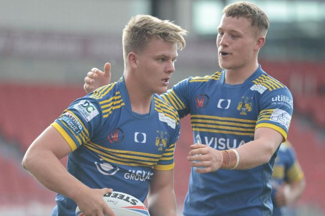 Oliver Greensmith, left, scored twice in the win over Rochdale. Photo: Rob Terrace