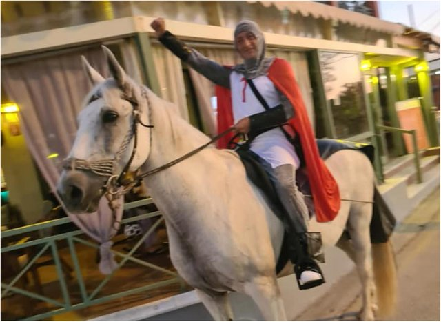 England fan Terry Hill, who dubs himself Donny Knight, rode through the streets of Corfu on horseback.