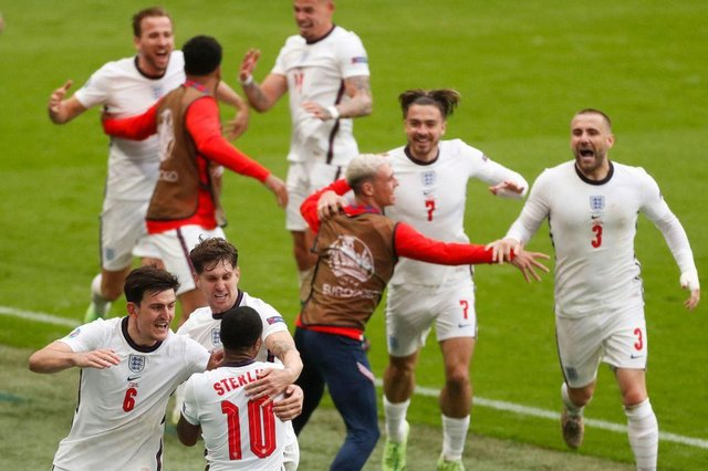 England's players celebrate Raheem Sterling's opening goal against Germany. Photo by MATTHEW CHILDS/POOL/AFP via Getty Images