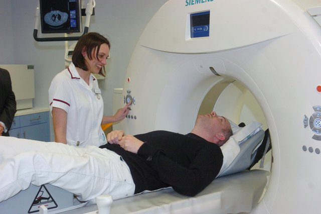 Doncaster Round Table charity officer Pascal Davis is given a demonstration of the Scanner which him and his members helped to provide, by superintendant radiographer Sarah Gibson. Picture: Liz Mockler D1839LM