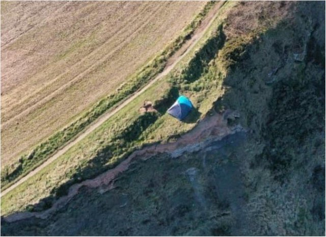 The couple's tent was found perched on a cliff in North Yorkshire. (Photo: HM Coastguard).