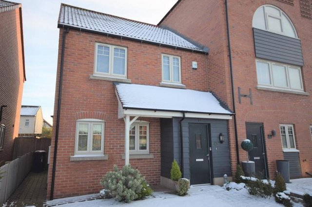 Two bedroom end town house situated in a courtyard development.