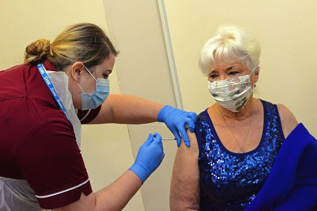 Jeannette Adams, of Bessacarr, is the second patient to recieve the Covid-19 Vaccination in Doncaster. Picture: NDFP-15-12-20-CovidVaccine 5-NMSY