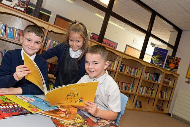 James Susek, Kadie Priestley and Callum Pearman, all seven, pictured in the school library. Picture: NDFP-12-11-19-DenabyMainPrimary-1