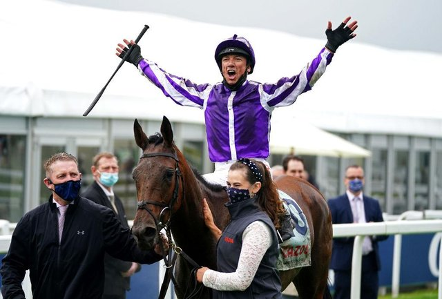 Frankie Dettori celebrates after winning the Cazoo Oaks with Snowfall at Epsom. Photo by John Walton - Pool/Getty Images
