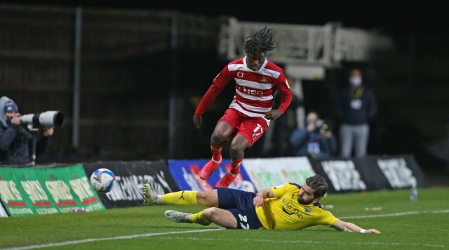 Oxford United's Elliot Lee slides in on Taylor Richards. Picture: Gareth Williams/AHPIX