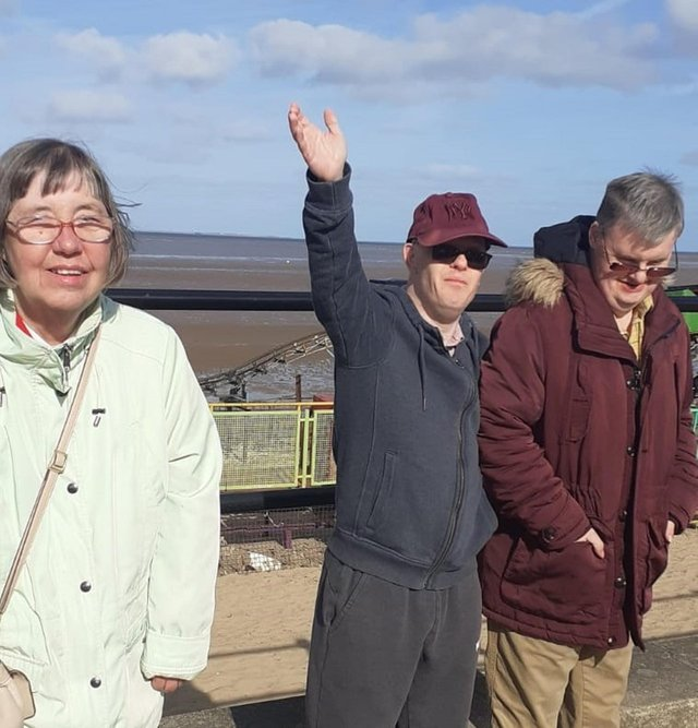 Residents' Denise Broadbent, Lee Balmer and Mark Nicholls enjoy a day trip to the local beach, following new government guidance meaning care home residents can now visit outdoor public places without self-isolating when they return to their care homes.