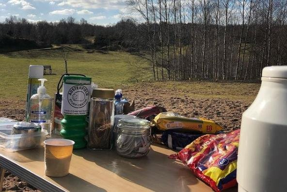 Claire's bench set up with coffee, tea and biscuits.
