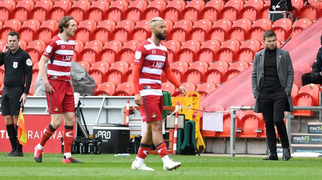 A dejected Andy Butler looks on