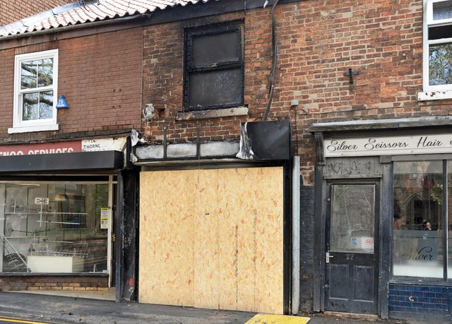The business on King Street, which was set on fire after a Car crashed into the front.  Picture: NDFP-04-05-21-ThorneFire 2-NMSY
