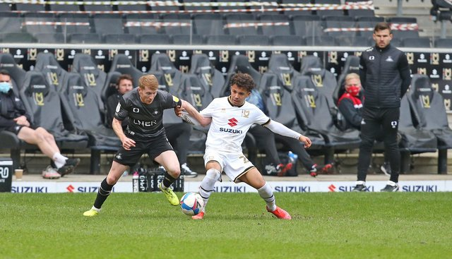Brad Halliday tussles with MK Dons' Matthew Sorinola as Andy Butler looks on. Picture: Gareth Williams/AHPIX