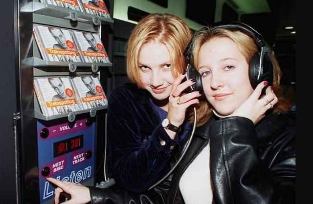Jenny Newsham and Gemma Bush both aged 16. Listening to music in HMV.
