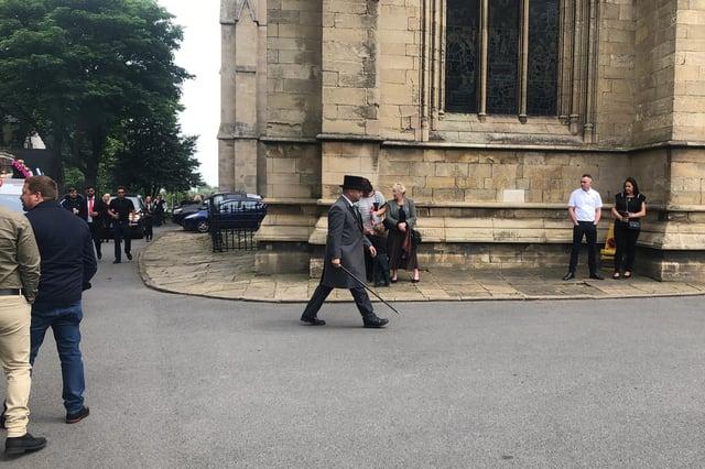 The cortege arrives at the minster