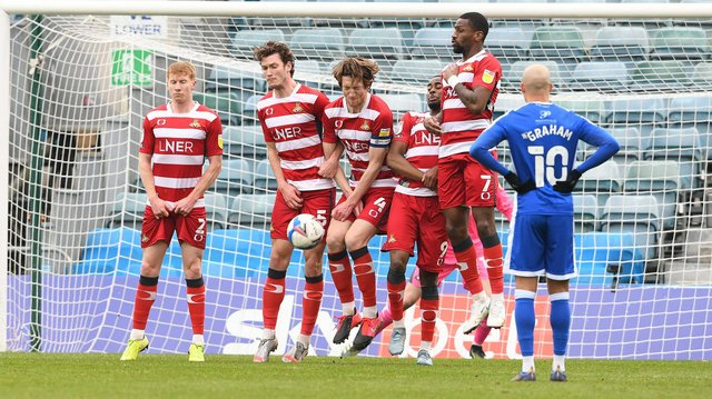 Rovers block a free kick from Gillingham. Picture: Howard Roe/AHPIX