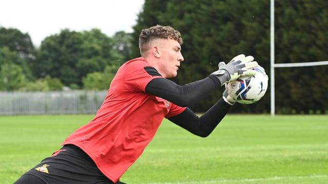 Goalkeeper Louis Jones does some handling work this week in pre-season training