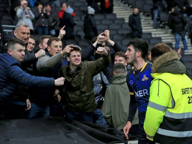 Doncaster Rovers defender Danny Amos celebrates with the fans