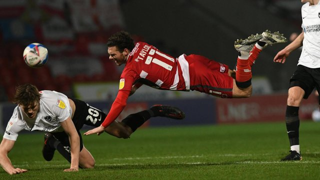 Jon Taylor tumbles during the win over Portsmouth. Picture: Howard Roe/AHPIX