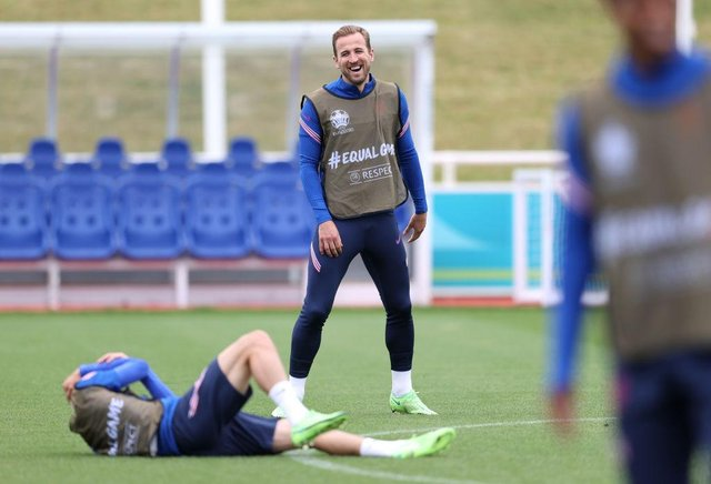 Harry Kane is all smiles during training. Photo by Catherine Ivill/Getty Images