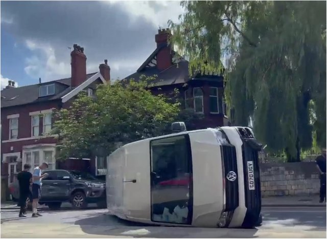 The van has overturned on Thorne Road. (Photo: Michael Pluskal).