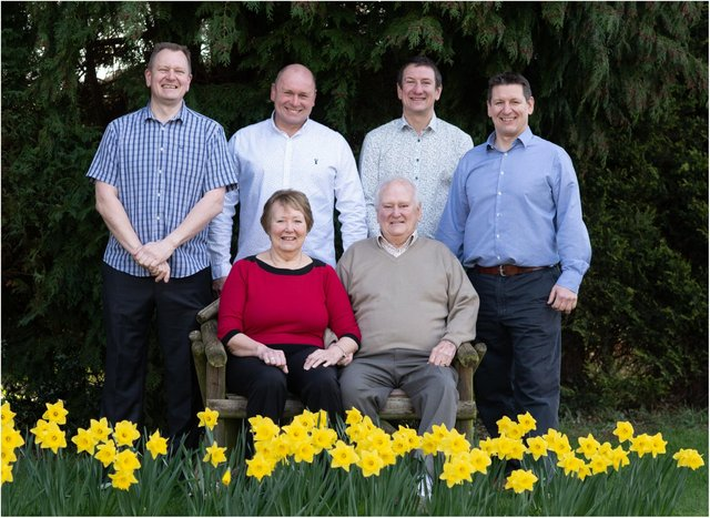 Garden centre boss Gary Plevey has died at the age of 81. Mr Plevey is pictured front right with his wife and four sons. (Photo: Pleveys Garden World).