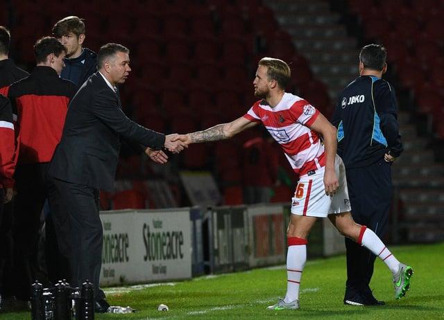 James Coppinger shakes hands with Darren Ferguson