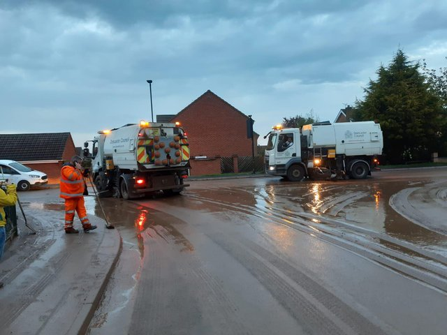 Council workers clearing up after the flash flooding in Adwick