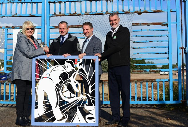 Brendan Carty, Harworth Group project manager, Duncan Armstrong, Harworth Group Associate Director and Richard Blakey, VHE Contracts manager, pictured presenting Susan Stephenson, with the restored gate panel. NDFP-08-10-19-RiverdalePark-3