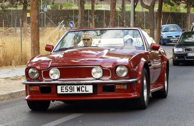 The Beckham's enjoying a trip in the classic car.