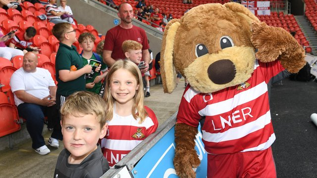 Young fans meet Rovers mascot Donny Dog