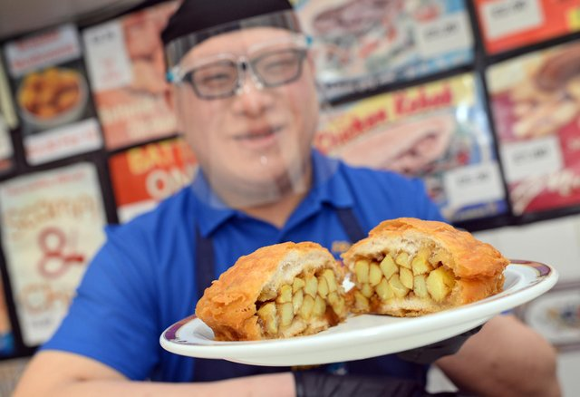 Paul Sung, pictured with his Battered Chip Butty.