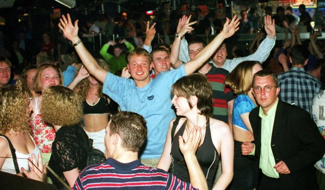 Revellers dancing in 1997