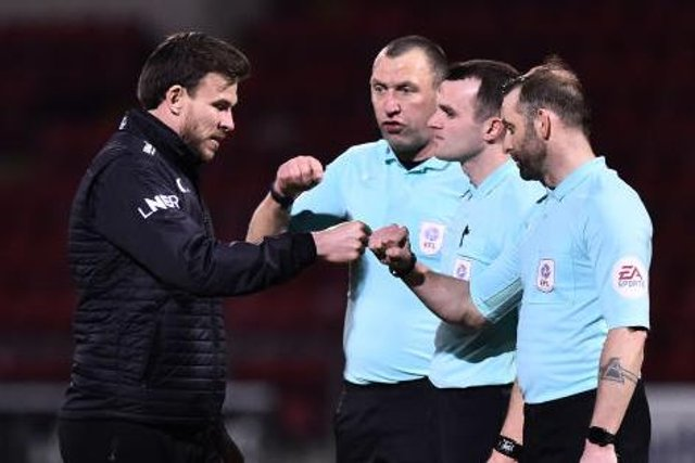 Andy Butler speaks to the officials after the defeat to Crewe. Photo: Nathan Stirk/Getty Images