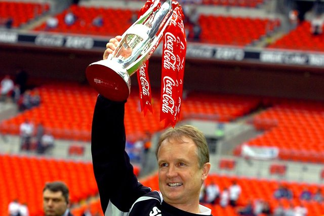 Sean O'Driscoll celebrates with the play-off trophy