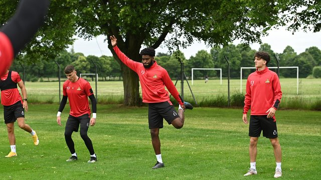 New signing Ro-Shaun Williams (centre) stretches alongside Louis Jones and Lirak Hasani