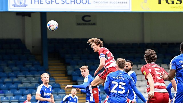 Tom Anderson heads Rovers back into the game against Gillingham. Picture: Howard Roe/AHPIX