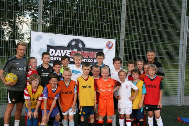 James Coppinger with Dave Penney and youngsters at the former Rovers boss' academy