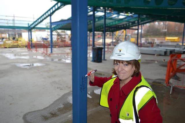 Councillor Nuala Fennelly, Doncaster Council cabinet member for Children's Services, signing a steel beam at the under-construction Carr Lodge Academy