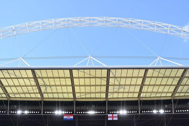 The England and Croatia flags are seen hung over the pitch at Wembley on the eve of their UEFA EURO 2020 Group D clash. Photo by GLYN KIRK/AFP via Getty Images
