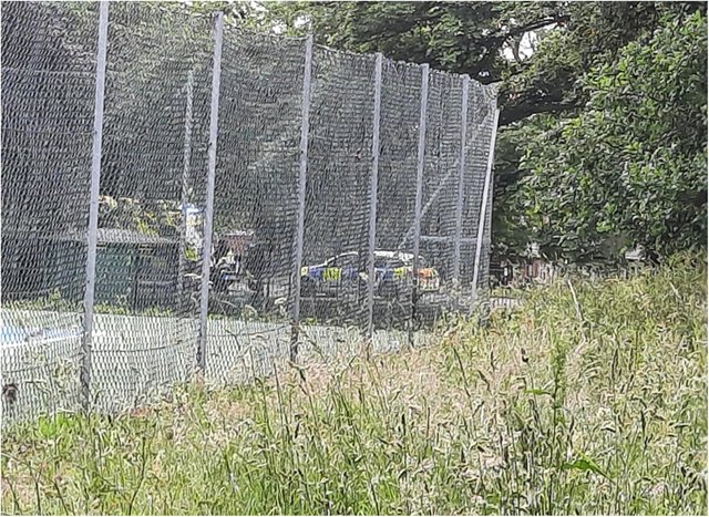 The police car and ambulance were pictured outside the entrance to Grove Park.