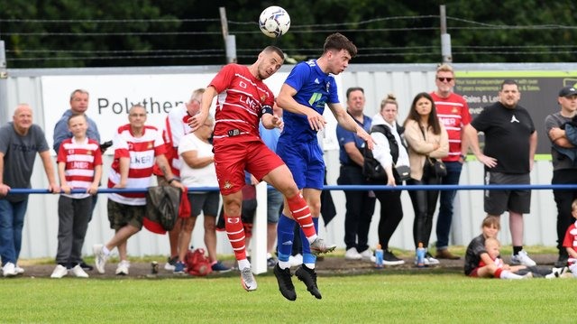 Tommy Rowe goes up for an aerial challenge against Rossington Main. Picture: Andrew Roe/AHPIX