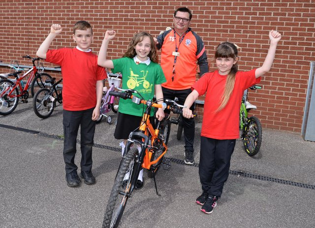 Terry Storey, LSA and Academy Bike It Ambassador, Tucker Watson, ten, Chloe Worth, ten and Amy Rose, ten, Bike It Crew members, celebrate coming 1st across Yorkshire and the Humber region. Picture: NDFP-18-05-21-SheepDipBike 2-NMSY